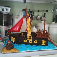 Pirate Ship A chocolate pirate ship cake. Iced in chocolate fudge icing with buttercream accents.