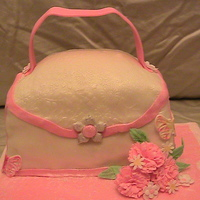 My First Purse Cake I made this cake for a couple of ladies that LOVE handbags. It was made with peach flavored icing, white and the duff fondant. I have never...