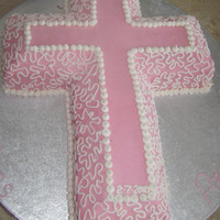 Pink Cross covered with buttercream, with a very quick lace job