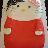 Hello Kitty Graduation Cake Made another one last night for 2010 but camera battery died. So posting this one. Darn, the 2010 came out much better! Carved, fondant.