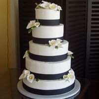 Wedding Cake Cala lilies and fabric ribbon on buttercream icing