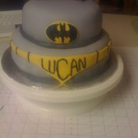 Batman Fondant Cake Batman cake duplicated for a friend. This time I used all marshmallow fondant over buttercream. There is also a black fondant cape around...