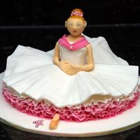 Ballerina Cake   My daughter's 4th birthday cake to take to kindergarten. From one of Debbie Brown's books.