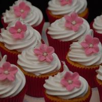 Marshmallow Icing   Some more cup cakes for my wife's birthday. Marshmallow icing, fondant flower with royal icing dots.