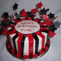"Black, White, And Red Stripes 8"" vanilla cake covered in buttercream icing and decorated with marshmallow fondant."