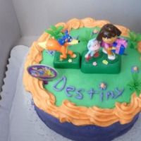 "Dora The Explorer Cake We made this 8"" double layered cake and 3 dozen cupcakes a few weeks ago for a birthday party."