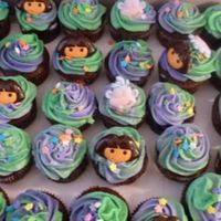 Dora The Explorer Cupcakes! We made 36 cupcakes and a cake for a birthday party a few weeks ago.