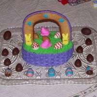 Easter Basket this is 2 oval cakes stacked on each other. The handle is a sugar cookie. I used peeps and homemade chocolate eggs to fill the basket (and...