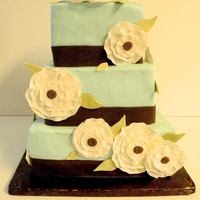 "Celebrate Cake Made ""fabric"" rosettes for this 40th birthday celebration cake"