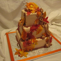 Fall Leaves Wedding Cake Handmade gumpaste fall leaves, twigs, acorns and berries. I was so happy with how this cake turned out, and I got a phone call later that...