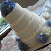 Hydrangeas And Pearls Wedding Cake Four tier cake, half dark chocolate with dark chocolate ganache filling, half vanilla with buttercreme filling. The hydrgangeas on the...