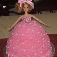Barbie Cake Barbie cake for a little girls party. Vanilla with buttercream icing with ediable pearls.