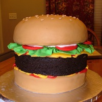 "Giant Hamburger Gianormous Triple Chocolate fudge cake (8"") with MMF and Ketchup, Must, and Mayo Buttercream (Vanilla). 7"" Tall"