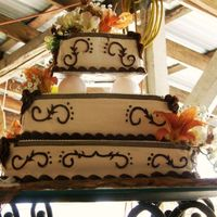 Western Theme Cake This was my first square wedding cake. Chocolate cake marbled with vanilla, and strawberry filling. Wipped cream frosting, with fudge...