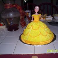 Belle Belle doll cake. I made 4 different cakes to go with the Beauty and the Beast theme. Belle, Mrs. Potts & Chip, Castle, and rose...