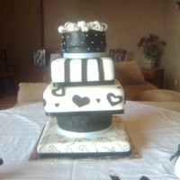 Black And White Wedding Cake  This cake was for my little sisters wedding with a black and white theme. The first tier is a dummy square cake with a dotted design. The...