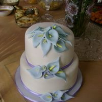 Jamie's Cake Here's a cake I made for a friend's bridal shower. It's covered in MMF with MMF calla lilies. The calla lilies were...