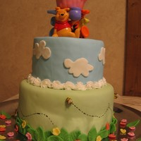"Pooh And Friends First Birthday Cake 6"" and 8"" rounds with a cupcake for the smash cake. Covered in MMF with MMF decorations and a BC border. Plastic figurines are..."
