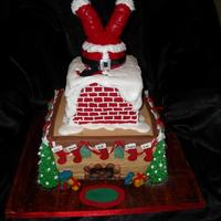 2010 Christmas Cake Christmas cake I did for our family get together. Bottom tier, Chocolate cake w/ choc. chips filled with Mint butter cream w/ mini choc....