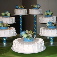 Modern Art Flowers This is the latest cake I made for a quinceanera. They gave me the lfower arrangements, and although I told them the size of the tiers, the...