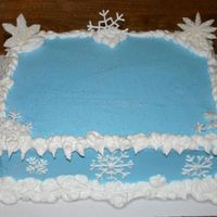 Snowflake Cake This cake was so much fun! Yellow cake with buttercream frosting. Snowflakes are royal icing and a few are fondant.