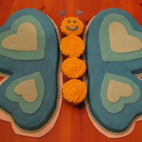 Blue Butterfly Blue butterfly for a 9 yr old girl's bday. I baked a 6 inch and 9 inch heart for the wings. Body is 4 cupcakes. This one was super fun...