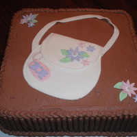 New Purse And Chocolate...girls Best Bday!  This is a chocolate cake with fudge filling covered in chocolate buttercream. The cookies lining the cake are also chocolate covered. The...