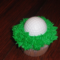 Fore!   The golfball was created with white melting chocolate using a golf ball mold.