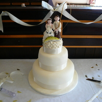 The Best Two Catches Fruit cake bottom and sponge middle tier fondant covered with royal iced fruit cake topper. Comical bride and groom topper. Groom being a...