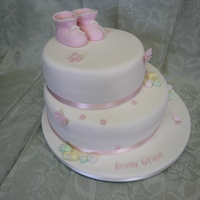 Bootee's Cake   baby's christening cake with boottee's topper