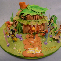 Tinkerbell's House tinkerbell's house and fairies( purchased toys) surrounding the cake house.