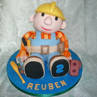 Bob The Builder Fondant paste covered sponge cake 3 d figure cake. Covered in fondant paste with modelling paste decoration.
