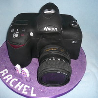Camera Cake Madiera sponge 3D cake covered in fondant paste modelled into a digital slr camera.