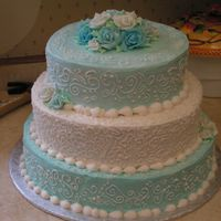 Turquoise And White.... Yuck Not my first choices of colors... This cake was so frustrating. It had been raining for days when I made the icing... humidity was a big...