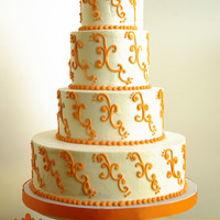 Orange Scrolls 4 tiers - 4,6,8,12. All buttercream with orange scrolls.