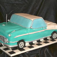 1956 Bel Air This was done out of 3 1/2sheets of cake. Covered with MMF. I also used rice krispy treats for the wheels covered in MMF.