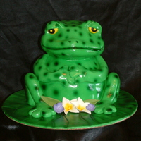 Frog On A Lily Pad This cake was made from two 8 inch round cakes and one 6 inch round cake for the body and the head was out of two 6 inch round cakes....