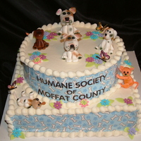 Humane Soceity Party All the litte figurines are made from gum paste and the patter that is on the side of the cake was printed onto edible sheet with edible...