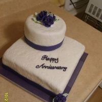 Anniversary Cake Top tier is 6 in. chocolate cake. Bottom is 10 in. square white cake. All covered in MMF.