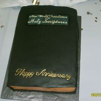 Bible Dark chocolate cake w/buttercream filling. Covered in fondant. THANKS to Godiva for the inspiration!!