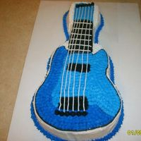 Guitar Cake Yellow cake covered in buttercream.