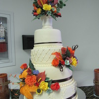 Pocono Autumn Wedding WASC cake filled with apricot/pineapple jam, covered in ganache and then MMF. Gumpaste flowers. This cake was for a close family friend who...