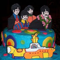 Topper For Beatle Cake This is the colorflow topper for a Beatle/Yellow Submarine birthday cake . Buttercream Icing, fondant accents, colorflow Beatle pictures....