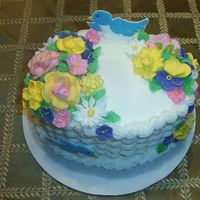 Wilton Class 2 Buttercreme Icing, RI Flowers, Colorflow birds & worm. I loved making the RI flowers. So much fun!
