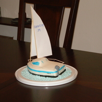 Sailboat Birthday Cake  I made this for my husband. It is chocolate cake with strawberry buttercream filling and a chocolate ganache under the MMF. This was my...