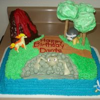 "Pokemon Birthday Cake  Each Pokemon is in its ""native element"". The trees are Pirohette Cookies with meringue cookie tops. The volcano is stacked cake..."