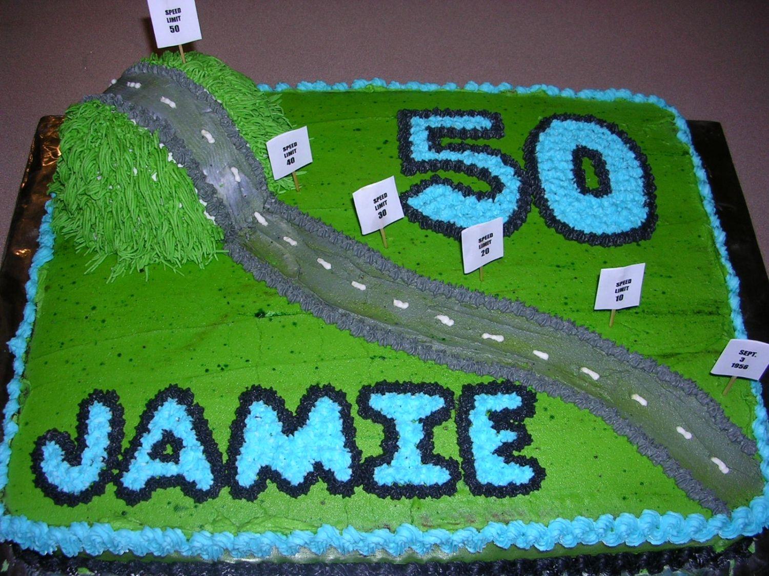 Down A Long Road And Over The Hill I designed this cake for my stepmother's 50th birthday party. The little signs are speed limit signs going from 0 to 50.