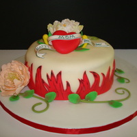 Tattoo Art Heart Red velvet cake, cream cheese buttercream filling. Fondant covered and decorated, with gumpaste peonies.