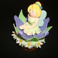 Tinkerbell Cupcake Tinkerbell and flowers are gumpaste, the grass is buttercream.