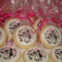 Bride And Groom Sugar cookies royal iced with fondant disk pressed onto royal icing then stamped with gel color mixed with rum.